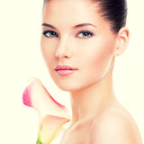 Beautiful face of young pretty woman with healthy skin. Royalty Free Stock Image