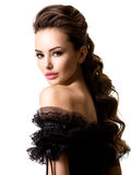 Beautiful face of an young sexy woman in black dress. Posing at studio on white background Stock Images