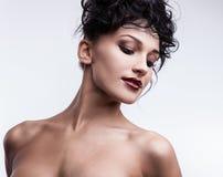 Beautiful face of young stylish woman on white background. Stock Photo