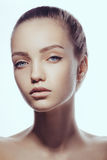 Beautiful face of young teen woman with clean fresh skin. Royalty Free Stock Images
