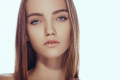 Beautiful face of young teen woman with clean fresh skin. Royalty Free Stock Image
