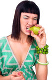 Beautiful face of young woman bitting pear Royalty Free Stock Photo