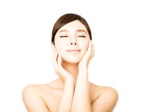 Beautiful face of young  woman with clean fresh skin Stock Image