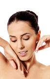 Beautiful face of young woman with clean fresh skin. Royalty Free Stock Image