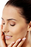 Beautiful face of young woman with clean fresh skin. Stock Photo