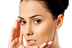 Beautiful face of young woman with clean fresh skin. Royalty Free Stock Images