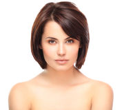 Beautiful Face of Young Woman with Clean Fresh Skin. Close up isolated on white. Beauty Portrait. Beautiful Spa Woman Smiling. Perfect Fresh Skin. Pure Beauty Royalty Free Stock Images