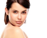 Beautiful Face of Young Woman with Clean Fresh Skin. Close up isolated on white. Beauty Portrait. Beautiful Spa Woman Smiling. Perfect Fresh Skin. Pure Beauty Stock Images