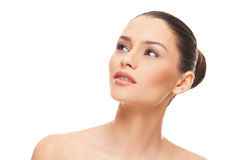 Beautiful face of young woman with clean skin on a white backgro. Und Stock Photos