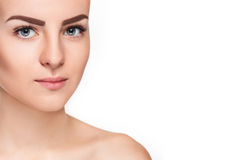 The beautiful face of young woman with cleanf fresh skin Royalty Free Stock Images