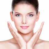 Beautiful face of young woman with cosmetic foundation on a skin Royalty Free Stock Images