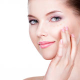 Beautiful face of young woman with cosmetic foundation on a skin Royalty Free Stock Photo