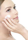 Beautiful face of young woman with cream Royalty Free Stock Photo