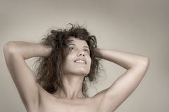 Beautiful face of young woman with curly hairs Stock Images