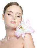 Beautiful face of young woman with flower Royalty Free Stock Photo
