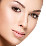 Beautiful face of young woman with health fresh skin Royalty Free Stock Images