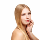 Beautiful face. Young beautiful woman with long blond hair touchs her face isolated on white background Royalty Free Stock Photography