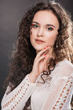 Beautiful face of young woman with long curly hair. Stock Photo