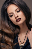 Beautiful Face of Young Woman with professional make up, dark red lips Royalty Free Stock Photography