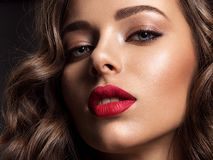 Beautiful face of young woman with red lipstick royalty free stock photos