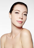 Beautiful face of young woman. Skincare, wellness, spa. Clean soft skin, healthy fresh look. Natural daily makeup Stock Images