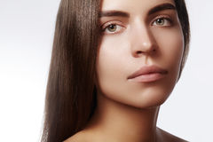 Beautiful face of young woman. Skincare, wellness, spa. Clean soft skin, healthy fresh look. Natural daily makeup Stock Photo