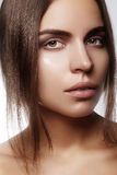 Beautiful face of young woman. Skincare, wellness, spa. Clean soft skin, healthy fresh look. Natural daily makeup.  royalty free stock image