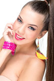 Beautiful-faced woman with feather earrings Royalty Free Stock Photography