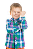 Beautiful fair-haired little boy in the joke shows Royalty Free Stock Image