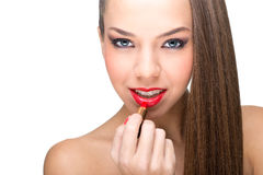 Beautiful fair skinned woman using a red lipstick Stock Image