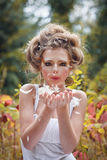 Beautiful fairy girl in a forest giving a kiss Royalty Free Stock Image