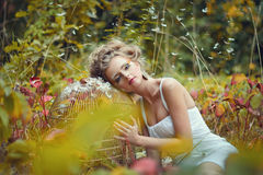 Beautiful fairy girl with golden cage in a forest Royalty Free Stock Images