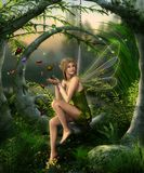 Beautiful Fairy Girl Playing with Butterflies in an Enchanting Fantasy Forest. Beautiful fairy girl with wings playing with butterflies in an enchanting fantasy stock illustration