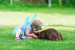 The beautiful fairy girl plays with a dog on grass Royalty Free Stock Images