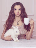 Beautiful fairy girl with rabbit Royalty Free Stock Photography