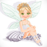 Beautiful fairy girl in white dress sit on floor Royalty Free Stock Photos
