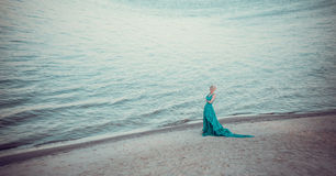 Beautiful fairy in a long turquoise dress Royalty Free Stock Photo