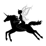Beautiful fairy riding on magical unicorn. Stock Images