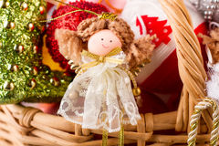 Beautiful fairy sitting in a wooden basket. Preparing for the New Year Stock Photo