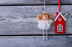 Beautiful fairy in a white dress and red house on a wooden fence Stock Photography