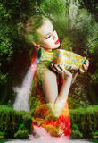 Beautiful fairy woman. Abstract beautiful fairy woman with jug in the waterfall woods Royalty Free Stock Photography