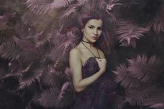 Beautiful fairy woman in magic forest portrait stock photo