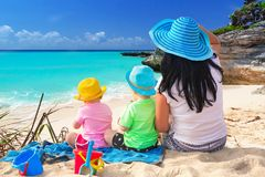 Beautiful Falassarna beach on Crete, Greece. Mother with twins on the tropical beach holidays Stock Image