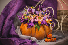 Beautiful fall bouquet in vase from pumpkin Royalty Free Stock Photography
