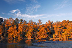 Beautiful fall colors forest. Reflected in river stock images