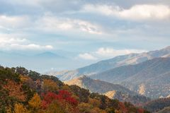 Beautiful fall colors trees and mountain vista autumn cloudy day, copy space. Horizontal aspect royalty free stock images