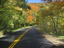Beautiful Fall Drive on a Winding Road Royalty Free Stock Images