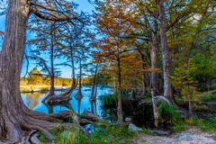 Beautiful Fall Foliage Surrounding the Crystal Clear Emerald Frio River Stock Photography