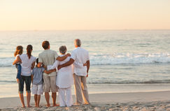 Beautiful family at the beach. Beautiful family watching waves at the beach Stock Image