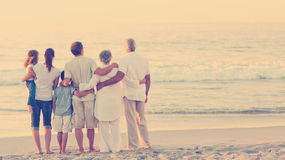 Beautiful family at the beach Royalty Free Stock Photos